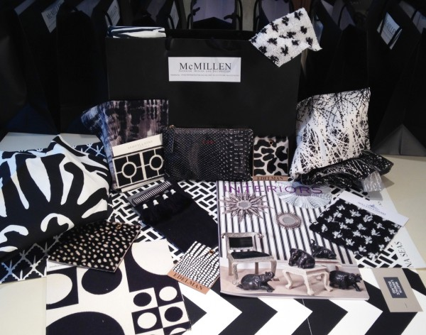 Our black bag surrounded by some of our favorite black and white fabrics, trims, and accessories.